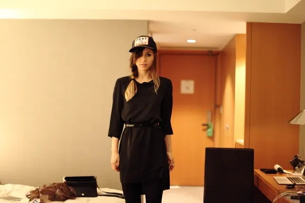 Rumi Neely wearing Bryanboy's hat in her room at the Cerulean hotel