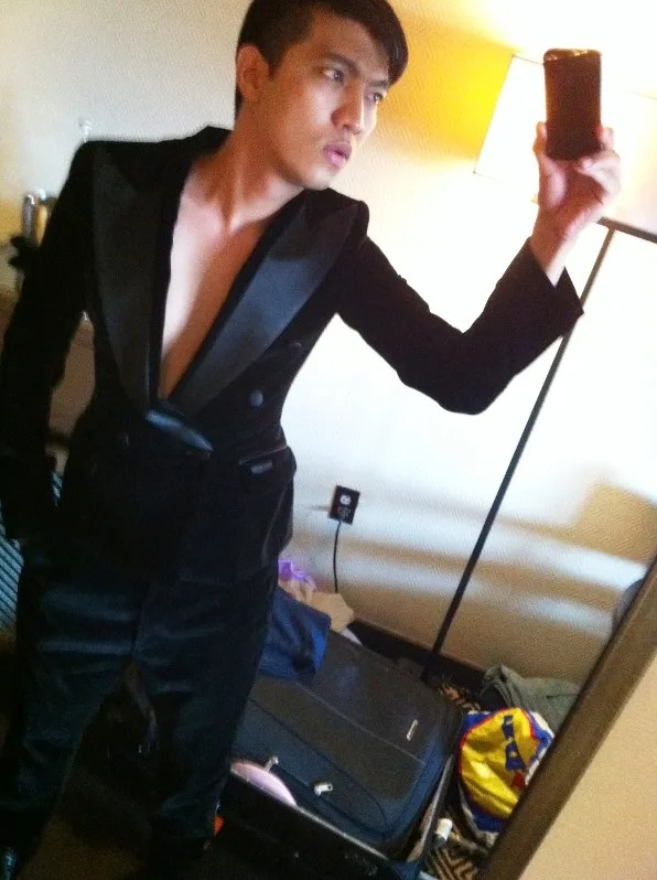 Bryanboy wearing a black velvet tuxedo courtesy of Dolce & Gabbana