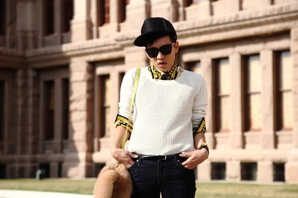 Bryanboy wearing a printed Versace shirt and J Crew sweater