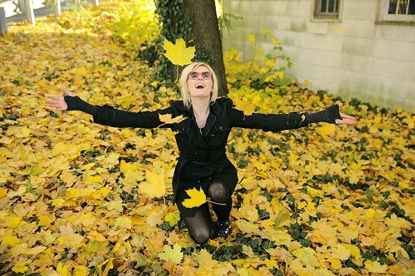 Sophie Sumner playing with leaves