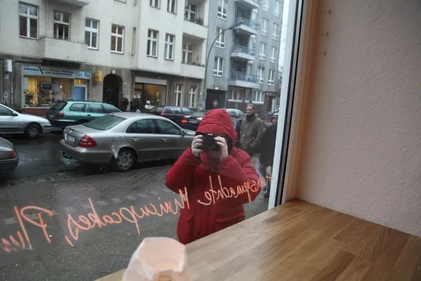Bryanboy being photographed inside a cafe in Berlin