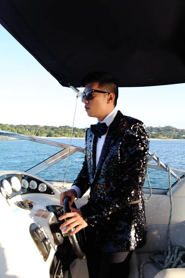 Bryanboy driving a speed boat