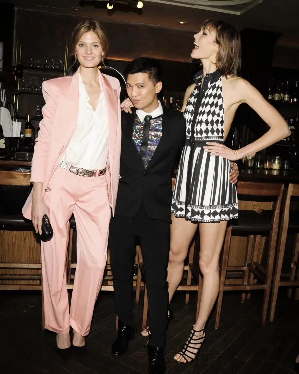 Constance Jablonski, Bryanboy and Karlie Kloss at the launch of 'The Pierre' handbag by Balmain at Red Rooster restaurant, New York City