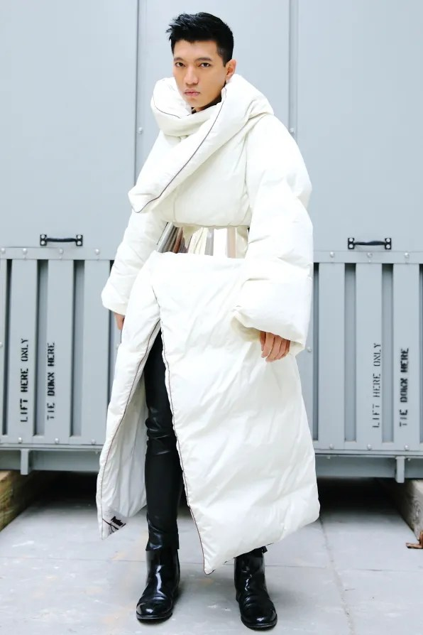 Bryanboy wearing a Maison Martin Margiela x H&M collaboraton comforter coat
