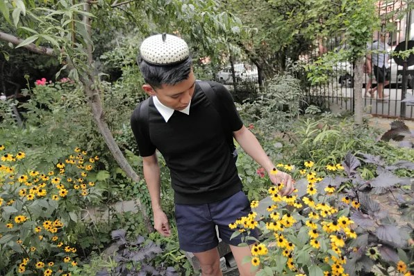 Bryanboy looking at flowers at 6th and Avenue B Community Garden