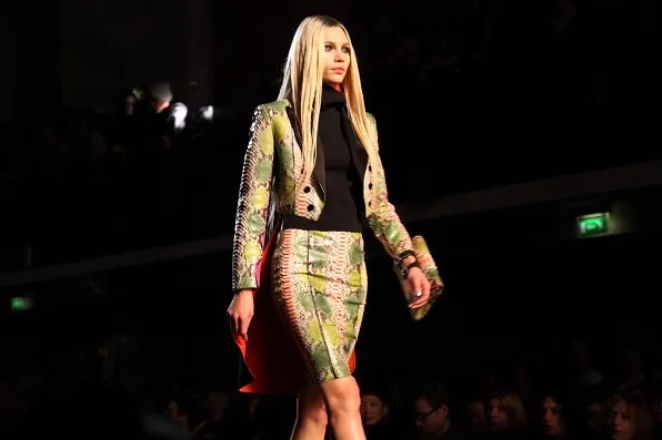 Aline Weber wearing a python skirt and jacket at Jean Paul Gaultier Fall Winter 2012 fashion show