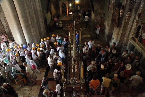 Christian pilgrims inside Church of the Holy Sepulchre