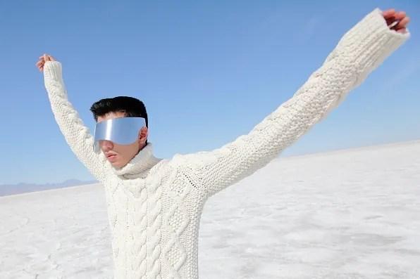 Bryanboy wearing a Michael Kors turtleneck and Alexander McQueen visor sunglasses