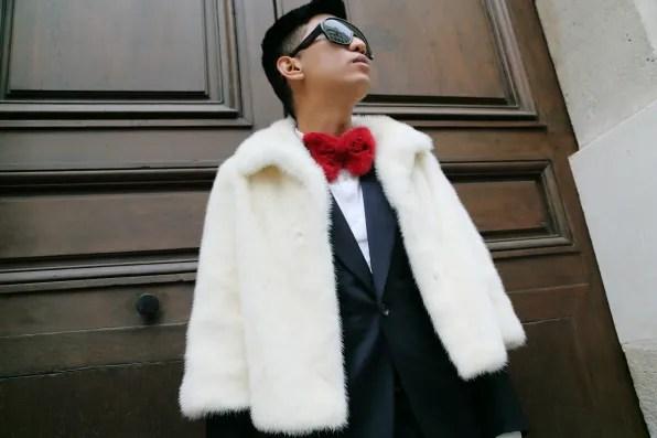 Bryanboy wearing a white Adrienne Landau mink fur bolero