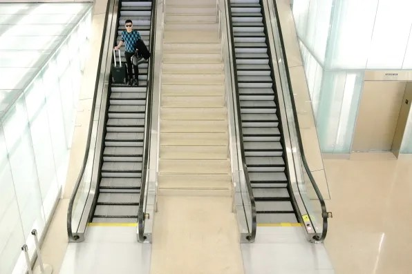 Bryanboy going down the escalators at Washington Dulles International airport