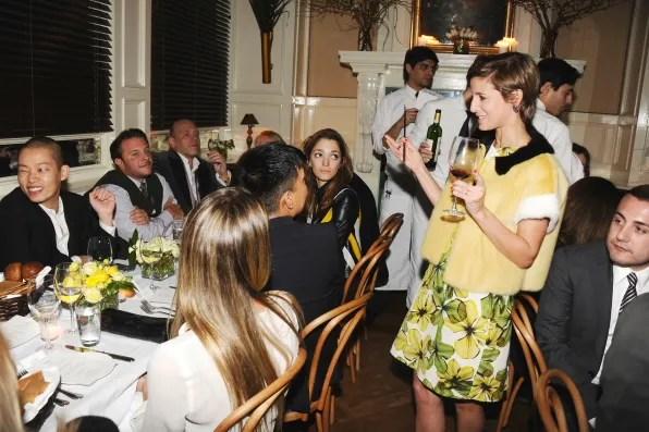 Cindi Leive toasting Jason Wu at Beatrice Inn