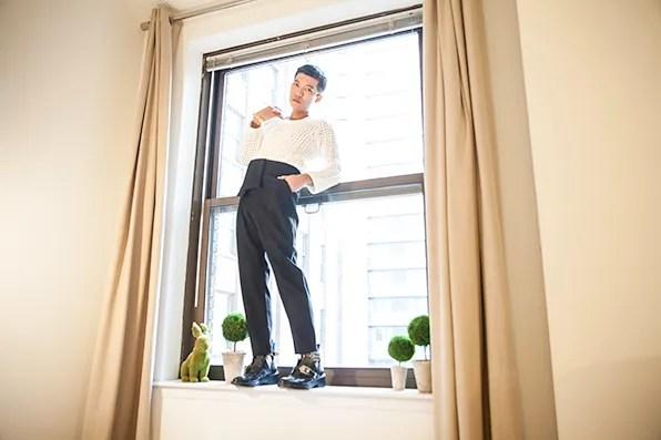 Bryanboy at home wearing Balenciaga sweater and Balenciaga pants