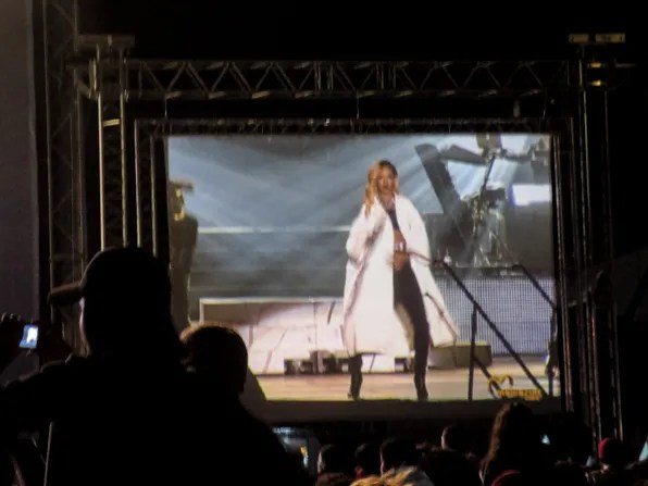 Rihanna wearing a Miu Miu coat on stage at 2013 Mawazine Maroc Rabat Morocco