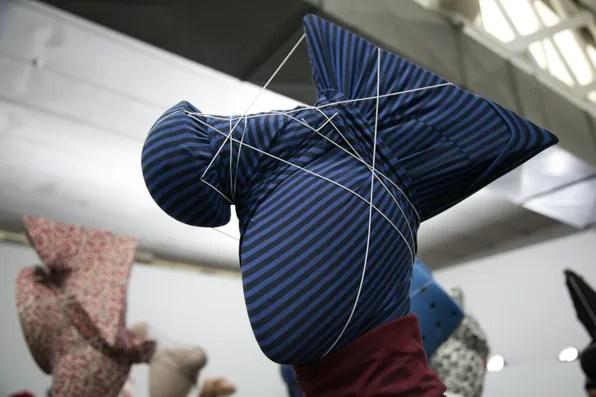 Blue geometric headpiece at Uniqlo Lifewear presentation