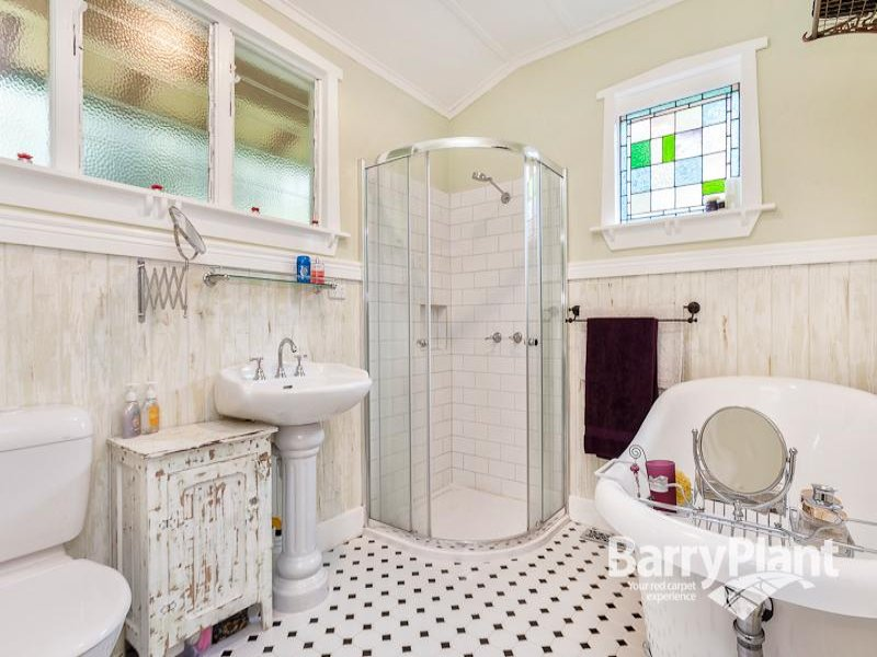 French provincial bathroom design with freestanding bath using stained