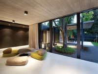 Dining-living living room using brown colours with ...