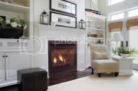 bookshelves around a fireplace with a vaulted ceiling