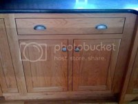 Knob placement on trash pull out cabinet