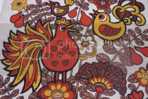 detail of teatowel with bird decoration