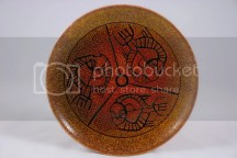 Pottery plate decorated with three fish
