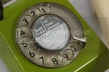 close up detail of green vintage trimphone