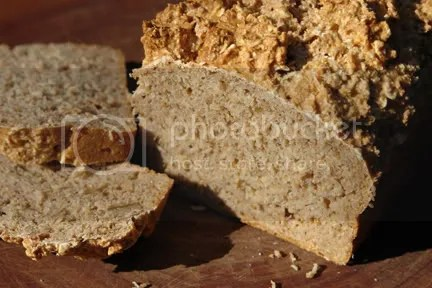 Sliced wholemeal sourdough loaf on a bread board