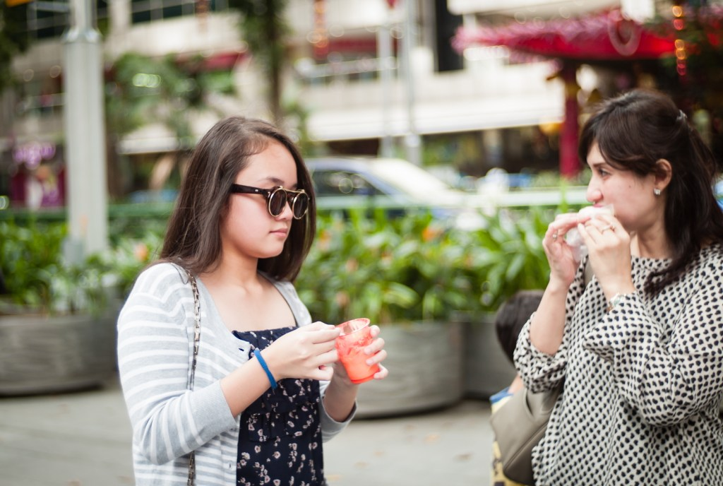 Two woman along Orchard Road