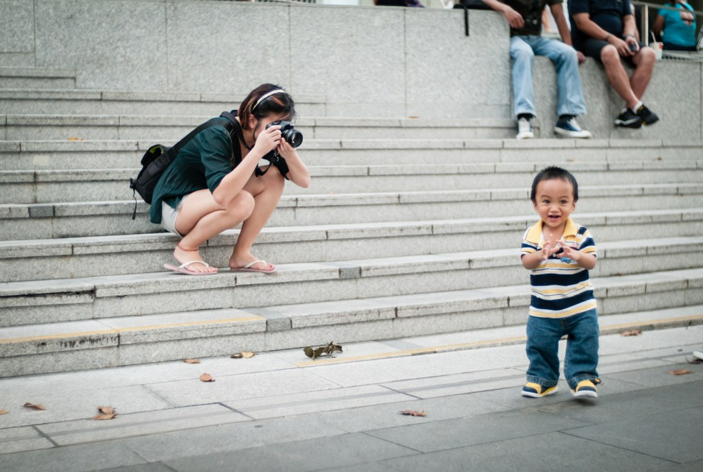 Photographer taking photos of a child