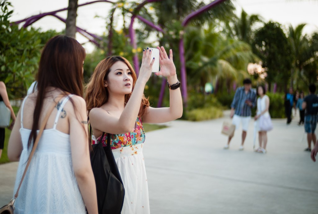 Girl taking photos with her iPhone