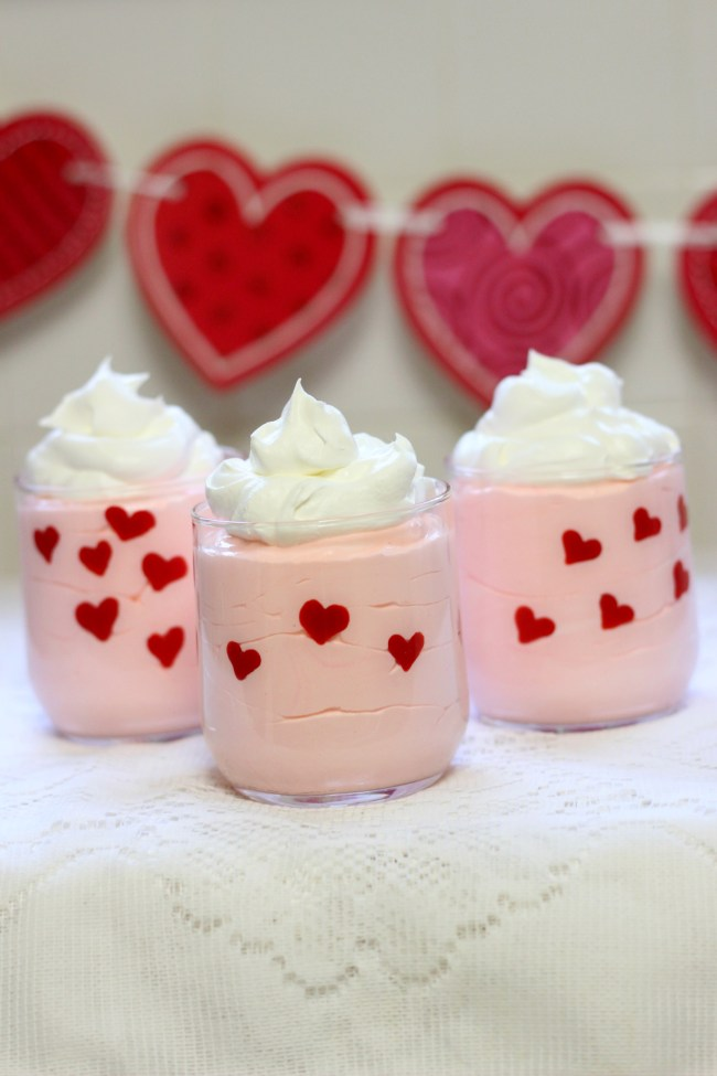Valentine's Day Easy Heart Dessert Cups made with pudding, whipped topping, and candy melts