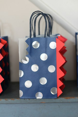 favor polka dot dinosaur tail bag