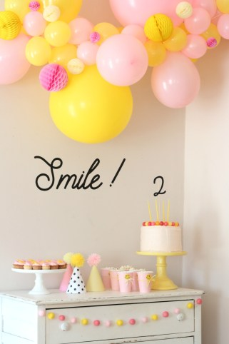 smiley face party balloon arch