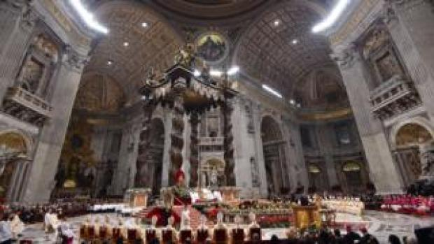 A general view shows Pope Francis celebrating a mass on Christmas eve to mark the birth of Jesus Christ on December 24, 2015 at St Pater's basilica in Vatican
