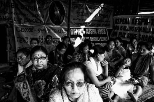 Meira Paibi's local female activists sit in a small shed built to house the supporters of Irom Sharmila, and Sharmila herself when she is released yearly. They sat to symbolically fast for four hours, November 4, 2013.