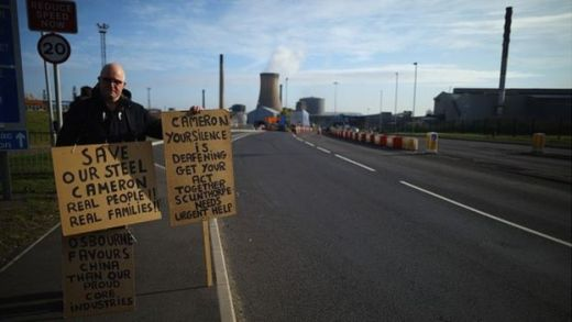 Lone demonstrator Neil Dawson protests in support of the UK steel industry outside the Tata Steel processing plant at Scunthorpe,