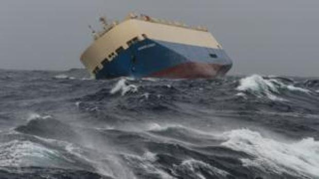 """In this photo taken on Sunday, Jan. 31, 2016 the cargo ship """"Moderm Express"""" is pictured drifting off the coast of France."""