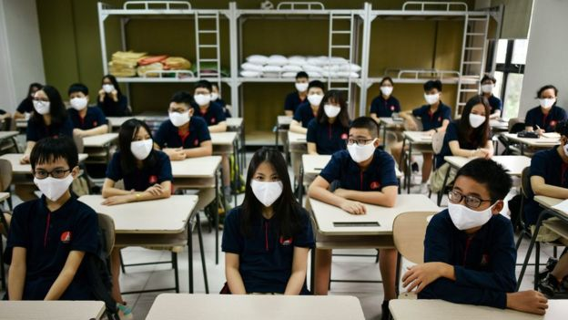 Students at their desks wearing masks at a school in Hanoi, Vietnam (4 May 2020)