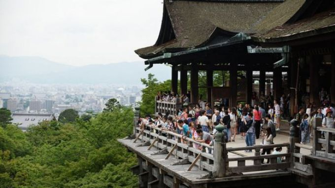 Tourists at a temple in Kyoto
