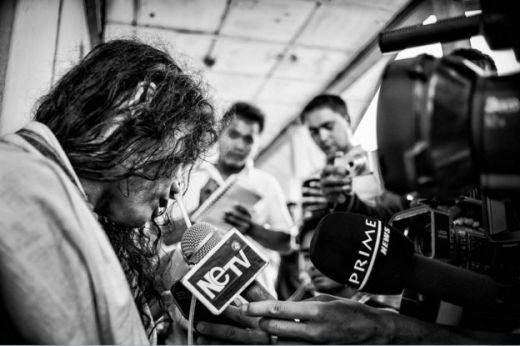 Surrounded by local press looking for a comment on the latest politcal upheaval from Irom Sharmila, June 13, 2013.