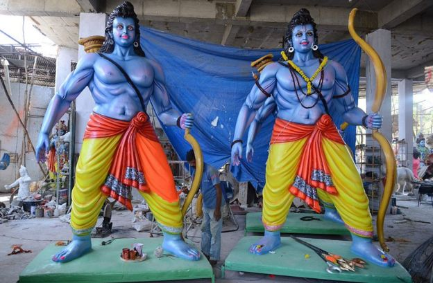 An Indian artist puts final touches to statues of the Hindu God Lord Ram in Hyderabad on April 13, 2016