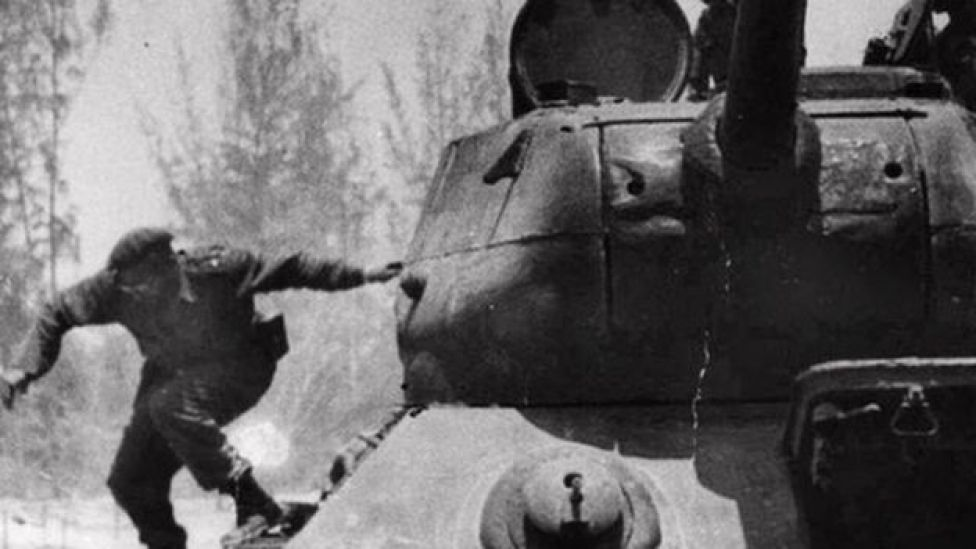 Fidel Castro leaps from a tank