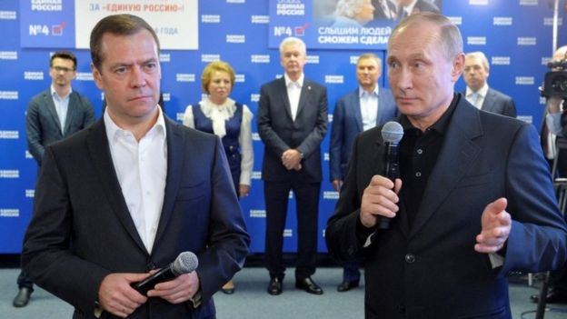 Dmitry Medvedev (L) and Vladimir Putin