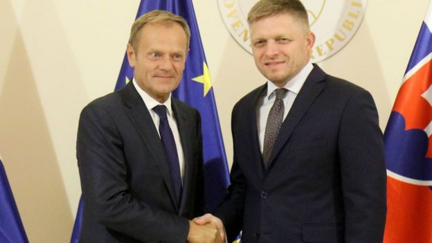 Slovak Prime Minister Robert Fico, right, welcomes European Council President Donald Tusk, left, for talks at the Presidential Palace prior to an EU summit in Bratislava on Thursday, 15 September 2016.