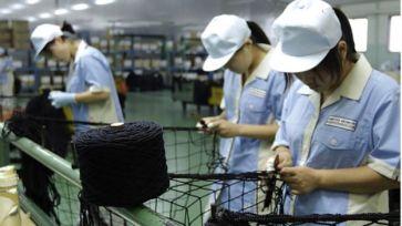 Empleados de la empresa japonesa Nitto Seimo, especializada en redes de pesca.