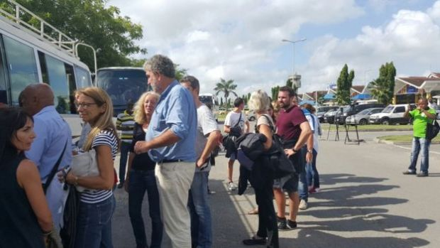 Passengers from Air France flight queue for a bus