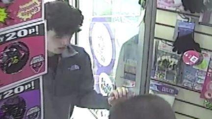 Matthew Cassidy entering a shop behind his murderer