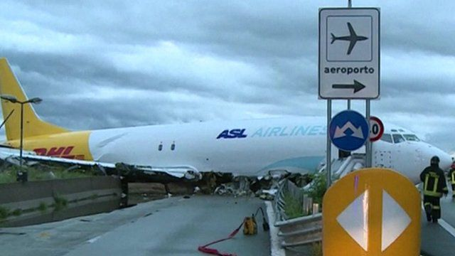Cargo plane overshoots runway in Italy - BBC News