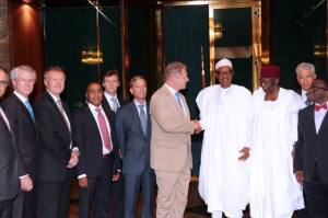 President Buhari poses with the Global Fund team