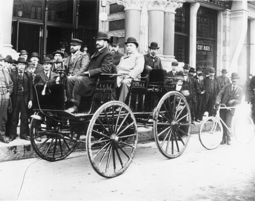 "1896: ONE OF THE FIRST ELECTRIC AUTOMOBILES IN MINNEAPOLIS Harold Sturgis is the car owner. Photo taken on April 14, 1896. Sturgis and Haskell are in the front, the others are behind. Front entry of the hotel is visible. Crowd of men are looking at the car. Car was exhibited at the 1896 Bicycle Show held in the Exposition Building. This car was invented by an Iowan named Morrison who sold it to Sturgis. (Steve: I'm about to buy a plugin hybrid and wonder ""What if?"" electric cars had continued their evolution)"