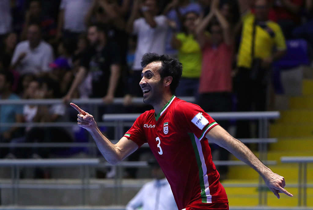 BUCARAMANGA, COLOMBIA - SEPTEMBER 24: Ahmad Esmaeilpour #3 of Iran celebrates after scoring the go-ahead goal late in the second half of extra time during quarterfinal match play between Paraguay and Iran in the 2016 FIFA Futsal World Cup at Coliseo Bicentenario on September 24, 2016 in Bucaramanga, Colombia. Iran defeated Paraguay 4-3 in extra time.  (Photo by Victor Decolongon - FIFA/FIFA via Getty Images)
